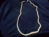 Pearl necklace, Jewelry, 14 karat white gold clasp, about 20 inches long, Wild cream colored pearls with a deep luster on 14 karat white gold clasp about 100 pearls with small on ends graduating to larger pearls to the center