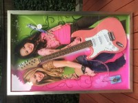 signed Miley Cyrus guitar and case with microphone and pass , Antique, Collectible, Miley C and Hannah Montana split guitar. She used it on her first tour.  Autographed and includes a backstage pass and microphone all held in a glass case