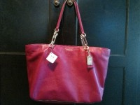 Coach Leather Handbag, Designer Wear & Handbags, The bag is by Coach, leather in a cranberry color, never used, and still has the original Coach price tag of $298 attached.