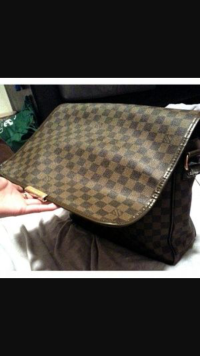 Louie Vuitton book bag , Designer Wear & Handbags, Brown outside, red on the inside silk