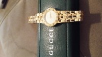 Gucci watch, Luxury Watch, Gucci, Womens 18 kt gold plated . Can not read info on back. Too small, looks like 3300 .
