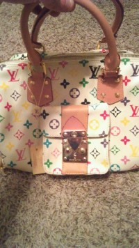 louis vuitton purse, Designer Wear & Handbags, Louis vuitton purse it's white with different color symbols. The serial number is VI 1013 in good condition