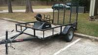 Utility trailer , Vehicle, 2012 - wood and metal, have a spare. model 10020 Ball size; 2. 5000lbs gross wt.  700 lbs tongue wt. SAE class III