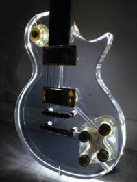 Les Paul acrylic lights up,  It's a heavy guitar, Gently used