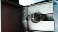 Movado Watch, Luxury Watch, Movado Sapphire Synergy Black Dial, It has a clip band .