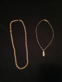 14k gold chains , Jewelry, 2 chains, weight unknown, 1 is a rope, 1 basic chain with doll emblem