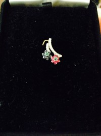 Ruby and Diamond Pendant, Two diamond stems dangle with a blue or  red ruby flower on each. The flowers have a green ruby center. , New, still in box
