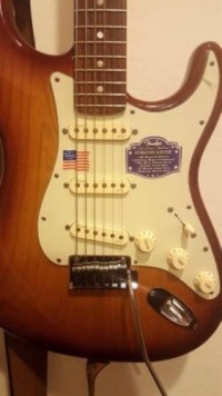 2013 Fender American Deluxe Stratocaster, Musical Instruments, Equipment, 8 months old, barely played, original plastic on all plastics, molded case, tobacco sunburst over ash body, locking tuners