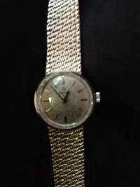 Womens 18 Karat White Gold Watch, Ladies Omega gold watch in very good conditions. Manuel wind with white silver dial. Total weight 37 grams., Like new