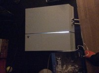 PlayStation 4 with fallout 4 game, Electronics, PlayStation 4, 2014, Special edition white PlayStation 4. With one controller. Also comes with Fallout 4 a game released two weeks ago.
