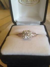 14kt gold Diamond Ring brand new, Diamond Ring  Diamond band 14kt Rose Gold with .50cts and center halo stone is .75cts. , Like new