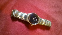 Movado T4A4028K, Luxury Watch, Movado T4A4028K, Scratch on face plate and stainless steel is worn and scuffed.