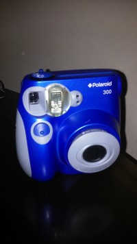 Fuji polaroid instax camera, Electronics, Fuji, 2013, It is blue and works well. There is one 3cm scratch in front but other than that it is like new.