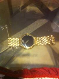movado water resistant watch, Men's Movado Swiss made water resistant watch..gold in color..stainless steel..saphire crystal like new, Like new