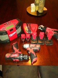 Milwaukee Tools, Tools, Equipment, Used M12 Milwaukee tools... Radio, Impact, Drill, Sawzall, 2 XC's batteries, 1  XC 4.0 battery, 2 red lithium batteries, and 1 charger