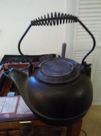 """cast iron kettle, Antique, Collectible, Black, cast iron, spring handle, solid, 8""""deep, like new, no cracks, vintage, nothing missing, flat top."""