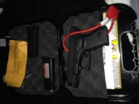 Flock 23, Gun, Glock 23 .40 S&W, Hard case, instructions, cleaning brush, 3 magazines, and lock