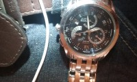 A Citizen eco- drive watch, Jewelry,  silver, weighs about 2pounds, It is a  very nice watch
