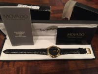 2 New Movado Museum Watches , Luxury Watch, Movado Museum, Black band, gold with black numberless face.  I have a His and Hers Matching..Brand new never been worn still on the boxes.