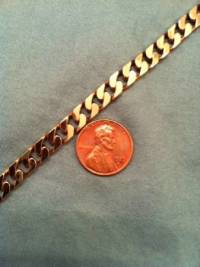 Cuban link, 38 grams 10k chain and cross.chain is 18 inch, Like new