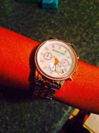 Women's Michael Kors Watch, Ladies michael kors watch its color is silver, gold and rose gold.Gently used, Gently used