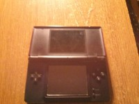 Nintendo DS Lite, It's red  and one of the hinges is broken.