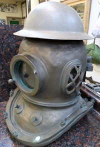 antique scuba gear and WWI helmet, Old scuba helmet and WWI doughboy helmet just for extra protection during the war.