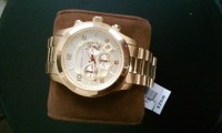 MEN MICHAEL KORS GOLD WATCH, NEVER BEEN WORN, NEED GONE ASAP, brand new purchased for 275 please help me get rid of it!