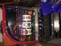 """Japanese slot machine - Big Guy, An antique Japanese slot machine, themed """"Big Guy,"""" accepts tokens (included), opens with key (included), fully functional. About the size of a standard Vegas slot machine."""