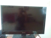 flat screen television, Emerson,flat screen, model number LC320EM2 A, Dolby digital,manufactered december 2012, funai corperation