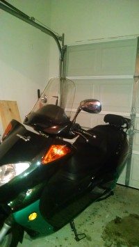 250ezscooter, It had only 250 miles.  Proof: http://i.imgur.com/qtMSNkp.jpg