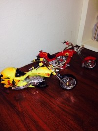 2 model size scale motorcycle s, 2 model collection Motorcycles with Fire Dept.features, one is red the other yellow, comes with certificate of authenticity,had them for a year and a half and are in great condition.