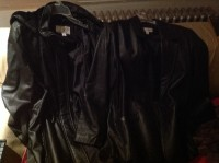 Leather coat,  2 leather coats: 1 with fur hood and 1 single breated. Both are black