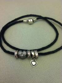 Pandora leather bracelet with charms, Authentic Pandora 3-strand leather bracelet w/ 2 charms and 3 spacers., Like new