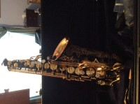 Black with gold etching alto saxophone, Yamaha Custom Z. Solid Black with gold and ivory keys.  In original leather case, new condition.