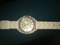 Watch , Coach watch color white in great condition never worn