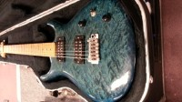 Kurt Wilson Guitar, Signed by the artist himself (Kurt Wilson), has a maple neck and the body is a beautiful blue color. The guitar was played on only a few times since purchased in the late 1990's/early 2000's.