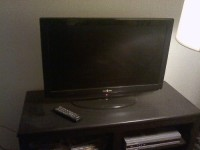 "picture of A Like Brand New 34"" inches HD flat screen TV, A Like Brand New HD Flat screen TV. TV is a 34"" inches and with remote control."