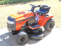 "Arien gear tractor, Model # 936060, 42"" precision gear tractor, cuts in reverse, 5 speed, with arm rest, color orange."