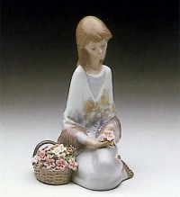 "Lladro figurine, Lladro ""Flower Song"" 1988 collector's society limited edition.  retired in 1989"