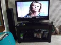Television with Stand, V Excellent condition. 32 inch LG with remote control. Perfect picture. Only a year old.Selling with stand which has 2 shelves for dvd player/gaming units etc., Like New