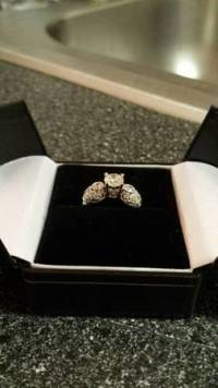 18 k white gold .90 ct round diamond engagement ring, 18 K white gold engagement ring with .90 ct round cut center stone with two .44 round side stones with paved setting around accent diamonds. Also has appraisal for insurance.The ring is a size 4, but can be sized up or down. , Like new