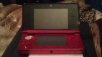 Nintendo3ds, Electronics, Nintendo 3DS, Barely used Nintendo 3DS. Got it for my son but he also got the new NintendoWII and hasn't touched it since Christmas, when he opened his gifts. Not once...we don't have a charger for it though, but it takes a 4.6v adapter, so it wouldn't be difficult to replace it. It comes with a2GB SD card, a free game if you want it (Pet Setter), and it's red and black.