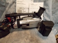 Canon GL2 professional video camera, Electronics, Canon GL2 , Digital video camcorder. 3CCD camera system, professional fluorite L lens. Includes battery pack, power adapter, lens hood, DC coupler, wireless controller, shoulder strap, instruction manual, use mini DV. Microphone is attached, great recording sound and video quality!