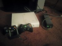 Xbox 360,2 Wireless Controllers,Wireless Adapter,120gbHardDrive, Electronics, Xbox 360 Arcade Console, Core Model, Used Xbox 360. Good Working Condition. Contains All Cords With A 120 GB Hard Drive. Turns On And Off. Works Like A New Xbox 360. Hardly Played It. The Only Problem Is That The Stickers Was Taken Off The Top, Leaving Many Sticky and Spots On Xbox. Can Be Covered Up Easily With A Xbox Skin Or Case. Other Then That The Xbox Is Good. 2 Working Wireless Controllers. One Is Missing The Battery Backing. Best Working Wireless Adapter. Everything Is In Good Conditions.