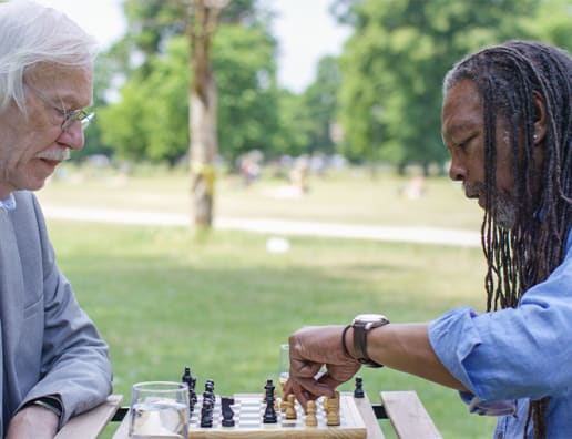 two mature men playing chess