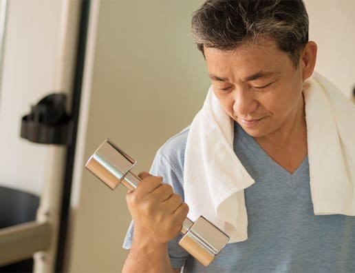 Asian man lifting weight