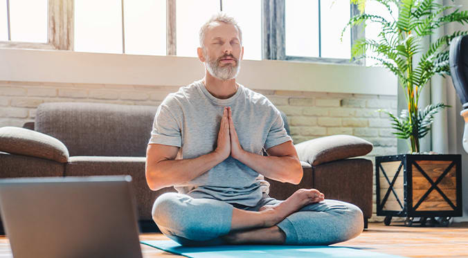 mature man doing yoga
