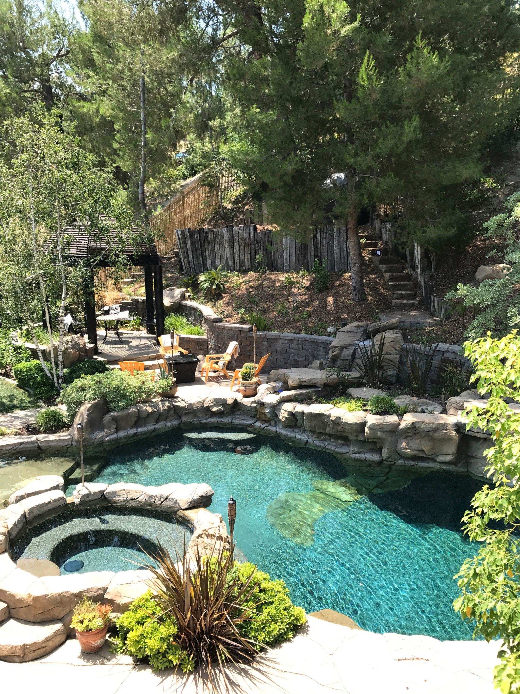 tranquil backyard with private pool waterfalls tub fire pit