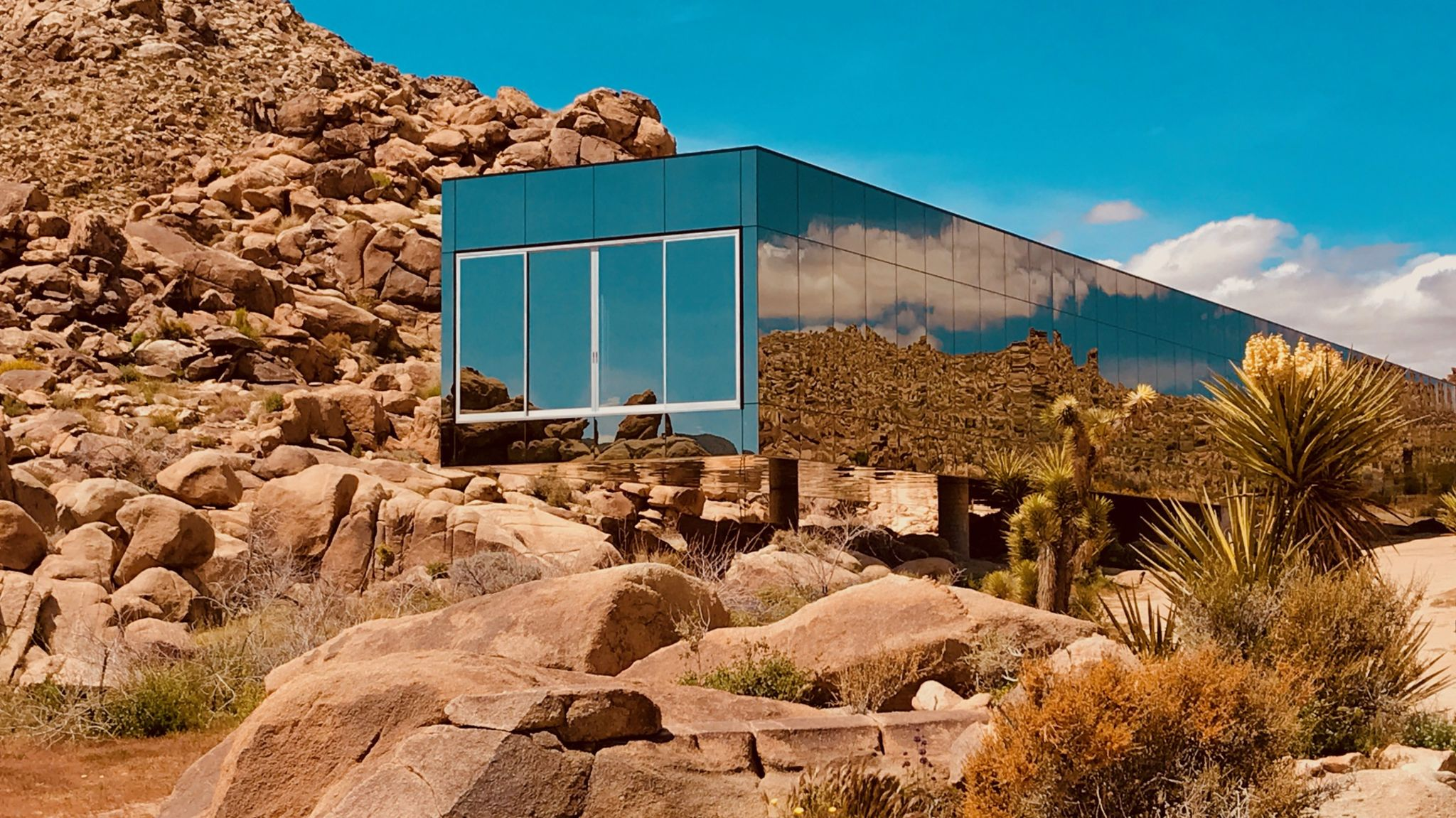 Invisible House mirrored nestled in 90 acres of rocks like another planet sci fi beyond, Joshua Tree, CA | Production | Peerspace